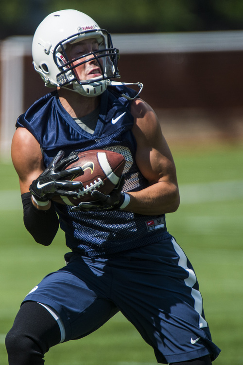 Chris Detrick  |  The Salt Lake Tribune Brigham Young Cougars tight end Brad Heap (82) makes a catch during a practice at Richards Building Fields Friday August 1, 2014.