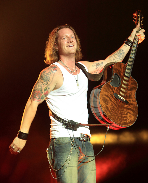 Tyler Hubbard of the country pop music duo Florida Georgia Line performs in concert at the York Fair on Tuesday, Sept. 10, 2013, in York, Pa. (Photo by Owen Sweeney/Invision/AP)