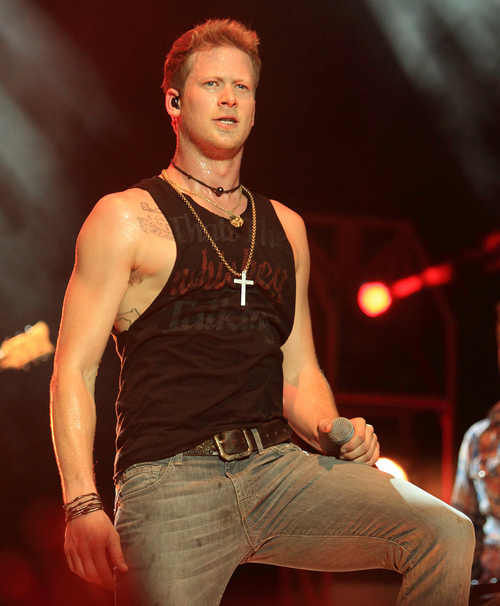 Brian Kelley of the country pop music duo Florida Georgia Line performs in concert at the York Fair on Tuesday, Sept. 10, 2013, in York, Pa. (Photo by Owen Sweeney/Invision/AP)