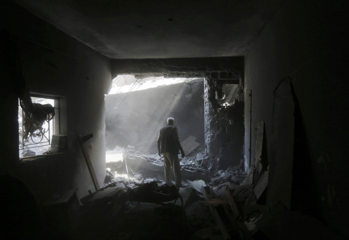 A member of the Shabat family inspects the damage upon returning to the family house, destroyed by Israeli strikes in the town of Beit Hanoun, northern Gaza Strip, Tuesday, Aug. 5, 2014. Israel and Hamas began observing a temporary cease-fire on Tuesday that sets the stage for talks in Egypt on a broader deal on the Gaza Strip, including a sustainable truce and the rebuilding of the battered, blockaded coastal territory.(AP Photo/Lefteris Pitarakis)