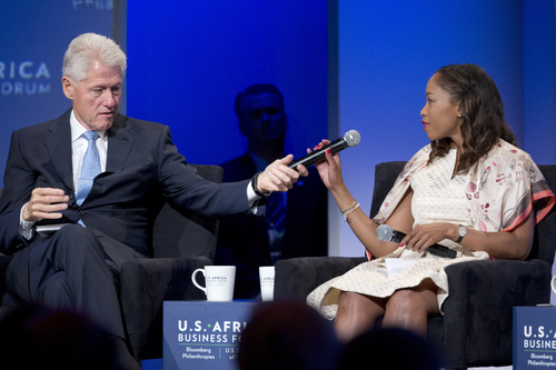 """Former President Bill Clinton, left, hands the microphone to Phuti Mahanyele, CEO of The Shanduka Group, during the panel, """"The New Era for Business in Africa"""" at the US Africa Business Forum during the US Africa Leaders Summit at the Mandarin Oriental Hotel Tuesday, Aug. 5, 2014, in Washington. Nearly 50 African heads of state are gathering in Washington for an unprecedented summit. (AP Photo/Jacquelyn Martin)"""