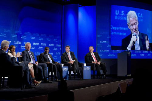 """From left, former President Bill Clinton moderates the panel, """"The New Era for Business in Africa"""" with Phuti Mahanyele, CEO of The Shanduka Group, Jeff Immelt, CEO of General Electric, Aliko Dangote, president and CEO of the Dangote Group, Doug McMillon, CEO of Wal-Mart Stores, Inc., and Andrew Liveris, CEO of The Dow Chemical Company, at the US Africa Business Forum during the US Africa Leaders Summit at the Mandarin Oriental Hotel in Washington, Tuesday, Aug. 5, 2014. Nearly 50 African heads of state are gathering in Washington for an unprecedented summit. (AP Photo/Jacquelyn Martin)"""
