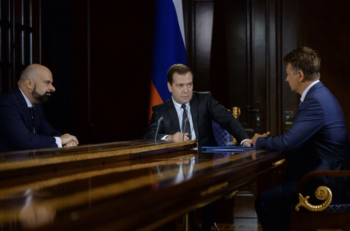 Russian Premier Dmitry Medvedev listens to transport Minister Maxim Sokolov, right, as the head of state controlled Aeroflot air lines Vadim Zigman, left, listens in the Gorki residence outside Moscow on Tuesday, Aug. 5, 2014. In July and August, tens of thousands of Russians sunning themselves on the beaches of Italy or the resorts of Turkey received an unpleasant surprise: the tour companies that had organized their trips had gone bust, stranding them in paradise and forcing them to pay their own way home. Sanctions imposed last week by the U.S. and European Union on key Russian industries could take months to bite, and so far the difficulties posed to Russia have been irritating but minor, from the closure of a low-cost airline to Crimea, to an oligarch's jet being stranded on the tarmac. But the recent collapse of Russia's tourism industry shows that cracks are already showing in the country's economy, after months of tension with the West and instability in neighboring Ukraine have sent its currency tumbling and investors scrambling. (AP Photo/RIA Novosti, Alexander Astafyev, Government Press Service)
