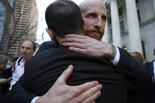 FILE - Plaintiffs challenging Utah's gay marriage ban Derek Kitchen, right, and his partner Moudi Sbeity hug after leaving court following a hearing at the U.S. Circuit Court of Appeals in Denver, Thursday, April 10, 2014. The court is to decide if it agrees with a federal judge in Utah who in mid-December overturned a 2004 voter-passed gay marriage ban, saying it violates gay and lesbian couples' rights to due process and equal protection under the 14th Amendment. (AP Photo/Brennan Linsley)