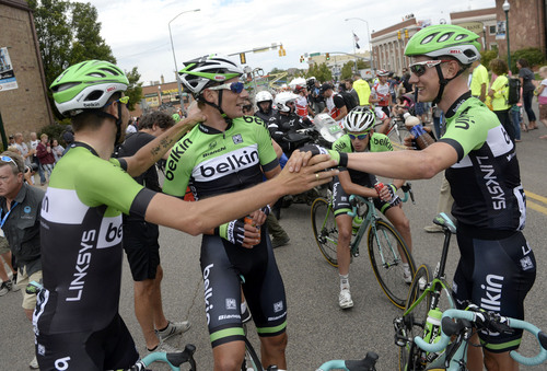 Al Hartmann  |  The Salt Lake Tribune  Members of team Belkin congratulate at the finish line at the Tour of Utah in Cedar City Monday August 4.  Moreno Hofland, right, won the first stage.