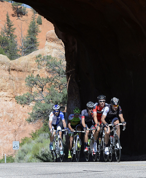 Al Hartmann  |  The Salt Lake Tribune  Five breakaway riders emerge from the tunnels in Red Canyon during the Tour of Utah second stage Tuesday August 5, 2014. The second stage of the race ran along scenic SR 12 from Panguitch to Torrey covering 130 miles. The race takes a northerly serpentine path through Red Canyon, Bryce Canyon National Park, Grand Staircase-Escalante National Monument and the Dixie National Forest. Racers ecountered 10,162 feet of climbing on this longest stage of the week, passing the towns of Tropic, Escalante and Boulder and downhill into Torrey.