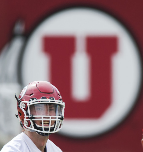 Steve Griffin  |  The Salt Lake Tribune  Utah quarterback Travis Wilson watches a pass down field during football practice at Rice-Eccles Stadium in Salt Lake City Monday, Aug. 4, 2014.