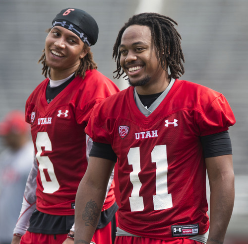 Steve Griffin  |  The Salt Lake Tribune   Utah receiver Dres Anderson, left, and receiver Kaelin Clay laugh as they leave the field following football practice at Rice Eccles Stadium in Salt Lake City, Utah Monday, August 4, 2014.