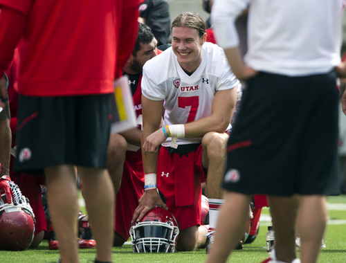 Steve Griffin  |  The Salt Lake Tribune   Utah quarterback Travis Wilson smiles as he takes a knee following football practice at Rice Eccles Stadium in Salt Lake City, Utah Monday, August 4, 2014.
