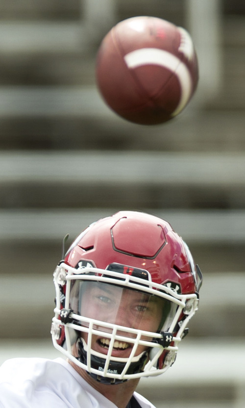 Steve Griffin  |  The Salt Lake Tribune  Utah quarterback Travis Wilson watches his pass to the sideline during football practice at Rice-Eccles Stadium in Salt Lake City Monday, Aug. 4, 2014.