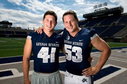 Lennie Mahler  |  The Salt Lake Tribune Utah State's Nick and Zach Vigil pose for a portrait during media day press availability at Romney Stadium in Logan, Utah, Aug. 4, 2014.