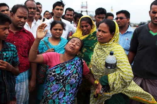 A Bangladeshi woman cries for her missing family members, victims of a ferry capsize, in Munshiganj district, Bangladesh, Tuesday, Aug. 5, 2014. Rescuers were struggling Tuesday to locate a sunken ferry that was overloaded and carrying hundreds of passengers when it capsized in the river Padma in central Bangladesh, leaving at least two people dead and probably many more. (AP Photo/A.M. Ahad)