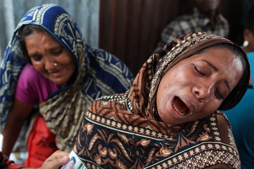 A Bangladeshi woman Mahomuda, right, cries for her missing mother, victim of a ferry capsize, in Munshiganj district, Bangladesh, Tuesday, Aug. 5, 2014. Rescuers were struggling Tuesday to locate a sunken ferry that was overloaded and carrying hundreds of passengers when it capsized in the river Padma in central Bangladesh, leaving at least two people dead and probably many more. (AP Photo/A.M. Ahad)
