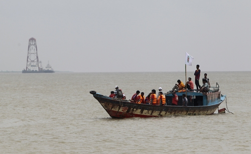 Bangladeshi rescuers search the River Padma after a ferry capsize in Munshiganj district, Bangladesh, Tuesday, Aug. 5, 2014. Rescuers were struggling Tuesday to locate a sunken ferry that was overloaded and carrying hundreds of passengers when it capsized in the river Padma in central Bangladesh, leaving at least two people dead and probably many more. (AP Photo/A.M. Ahad)