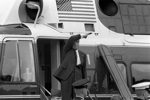 On the day of his resignation, Aug. 9, 1974, Richard M. Nixon waves goodbye from the steps of his helicopter as he leaves the White House following a farewell address to his staff.  The Watergate scandal forced Nixon to become the first U.S. president to resign from office.  (AP Photo/Chick Harrity)