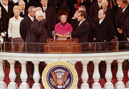 Richard M. Nixon, right, is sworn in as the 37th president of the United States administered by Chief Justice Earl Warren, left, during inaugural ceremonies in front of the Capitol in Washington, D.C., Jan. 20, 1969.  Shown behind Warren is former President Lyndon B. Johnson.  (AP Photo)