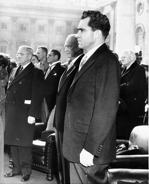 "Three United States Presidents stand solemnly on the inauguration stand in front of the Capitol, January 20, 1953, during the singing of ""The Star Spangled Banner"" in the ceremony in which Dwight D. Eisenhower was made president.  In the foreground is Vice President Nixon.  Immediately behind him is President Eisenhower.  At left is former President Truman, and at right is former President Hoover.  In background behind Truman and Eisenhower are Maj. John Eisenhower, the President's son, and Forrest Harness, senate sergeant-at-arms.  (AP Photo)"