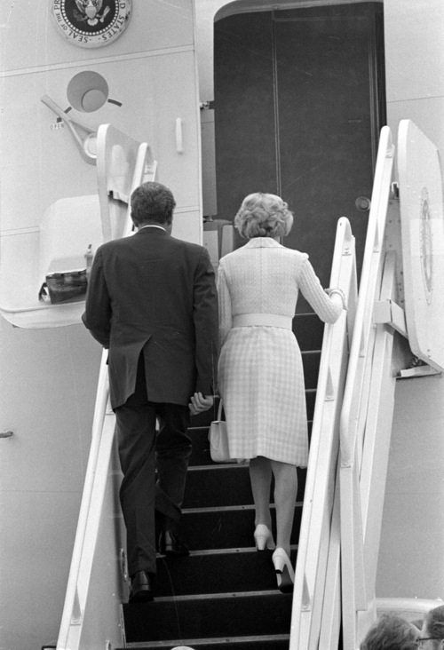 "President Nixon, whose resignation will become effective at 12 p.m. EST Friday, Aug. 9, 1974, boards the ""Spirit of '76"" with his wife, Pat, as they leave Andrews Air Force Base near Washington.  The plane's destination was San Clemente, Calif.  (AP Photo)"