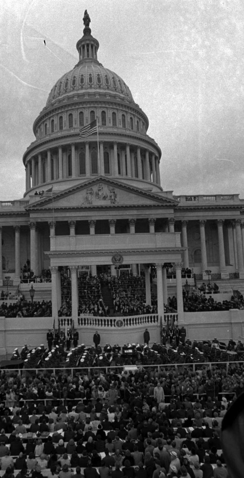Richard M. Nixon takes the oath as President of the United States on the steps of the U.S. Capitol in Washington on Jan. 20, 1969.  Justice Earl Warren administers the oath. (AP Photo)