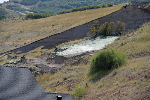 Al Hartmann  |  The Salt Lake Tribune  The scene of Tuesday's landslide.  Residents returned to their homes along Parkway Drive in North Salt Lake Wednesday Aug. 6, 2014, a day after a landslide destroyed a home and others had to be evacuated.