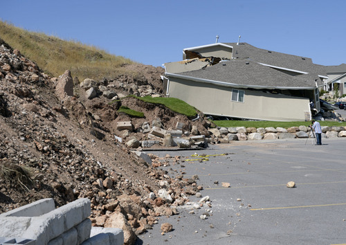 Al Hartmann  |  The Salt Lake Tribune  A home destroyed by landslide at Parkway Drive in North Salt Lake. Rubble from the landslide fell into the parking lot of Eagleridge Tennis and Swim Club next door. Residents returned to their homes Wednesday, a day after a landslide destroyed the home and others had to be evacuated.