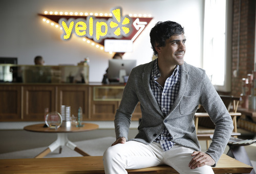 In this photo taken Friday, Aug. 1, 2014, Yelp CEO Jeremy Stoppelman poses at his company's headquarters in San Francisco. Stoppelman, 36, probably wouldn't be running Yelp Inc. if he had paid more attention to the opinions of outsiders than his own insights. (AP Photo/Eric Risberg)