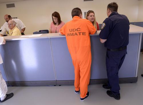 Al Hartmann  |  The Salt Lake Tribune  Prison inmate applies at the Utah Driver License Division office at the Utah Prison in Draper Tuesday July 8, 2014.