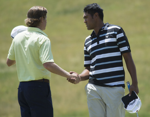 Steve Griffin  |  The Salt Lake Tribune   Lehi resident Tony Finau, right, shakes hands with Derek Fathauer after they finished their round during first round play in the Web.Com golf tour event at Willow Creek Country Club  in Sandy, Utah Thursday, July 10, 2014.