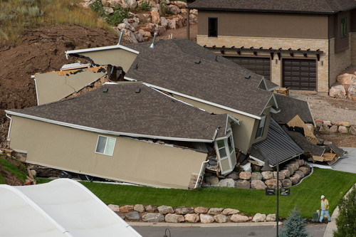Trent Nelson  |  The Salt Lake Tribune A large landslide in North Salt Lake destroyed this home and caused the evacuation of dozens more, Tuesday August 5, 2014.