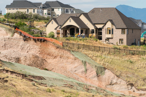 Trent Nelson  |  The Salt Lake Tribune A large landslide in North Salt Lake that destroyed one home and caused the evacuation of dozens more, Tuesday August 5, 2014.