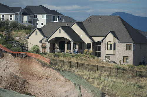 Jeremy Harmon  |  The Salt Lake Tribune  Landslide damage is seen very close to this home on the hillside above Parkway Drive in North Salt Lake on Tuesday, August 5, 2014.