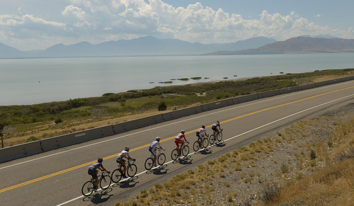 Leah Hogsten  |  The Salt Lake Tribune  2014 Tour of Utah leading cyclists pass by Utah Lake near Pelican Point during Wednesday's 118.3-mile stage from Lehi to Miller Motorsports Park in Tooele, August 6, 2014.