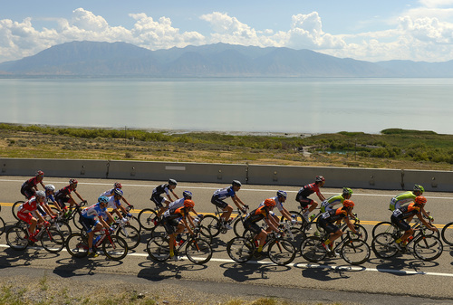 Leah Hogsten  |  The Salt Lake Tribune  2014 Tour of Utah cyclists pass by Utah Lake near Pelican Point during Wednesday's 118.3-mile stage from Lehi to Miller Motorsports Park in Tooele, August 6, 2014.