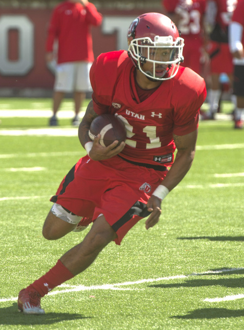 Rick Egan     The Salt Lake Tribune  Ute QB, Kendal Thompson looks to pass Troy McCormick runs with the ball during practice at Rice Eccles Stadium, Wednesday, August 6, 2014