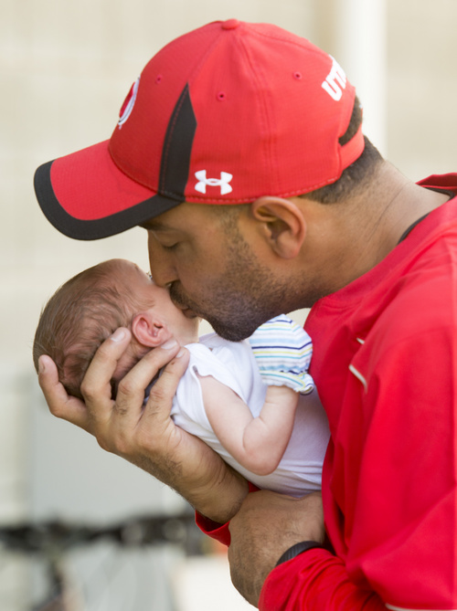 Rick Egan     The Salt Lake Tribune  Wide receiver coach, Taylor Stubblefield, kisses Jagger, his two-week-old baby boy after practice at Rice Eccles Stadium, Wednesday, August 6, 2014