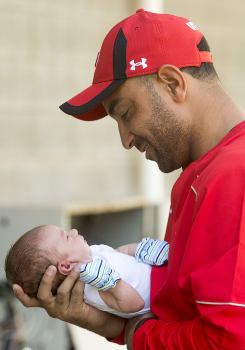 Rick Egan     The Salt Lake Tribune  Wide receiver coach, Taylor Stubblefield, holds Jagger, his two-week-old baby boy after practice at Rice Eccles Stadium, Wednesday, August 6, 2014