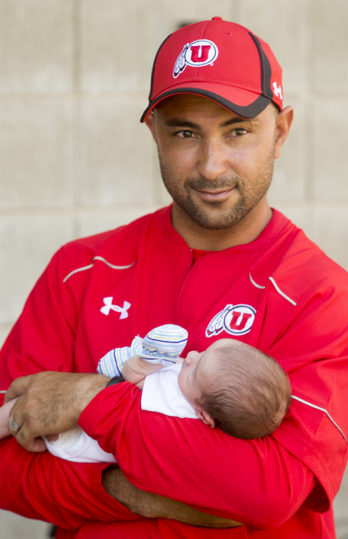 Rick Egan     The Salt Lake Tribune  Wide reciever coach, Taylor Stubblefield, holds his two-week-old baby Jagger, practice at Rice Eccles Stadium, Wednesday, August 6, 2014