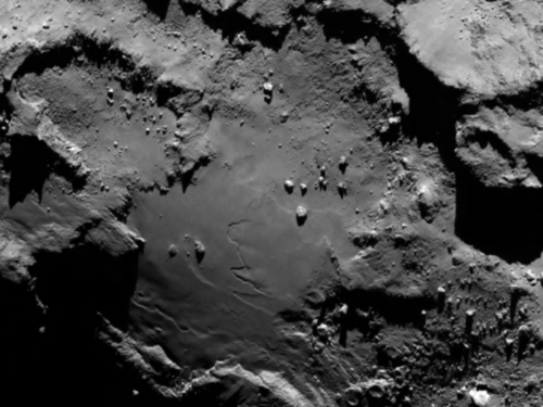 Close up detail focusing on a smooth region on the 'base' of the 'body' section of comet 67P/Churyumov-Gerasimenko. The image was taken by Rosetta's OSIRIS narrow-angle camera and downloaded Wednesday, Aug. 6, 2014. The image clearly shows a range of features, including boulders, craters and steep cliffs. The image was taken from a distance of 130 km and the image resolution is 2.4 meters per pixel. A mission to land the first space probe on a comet reaches a major milestone when the unmanned Rosetta spacecraft finally catches up with its quarry on Wednesday. It's a hotly anticipated rendezvous: Rosetta flew into space more than a decade ago and had to perform a series of complex maneuvers to gain enough speed to chase down the comet on its orbit around the sun. (AP Photo/ESA/Rosetta/MPS for OSIRIS Team )