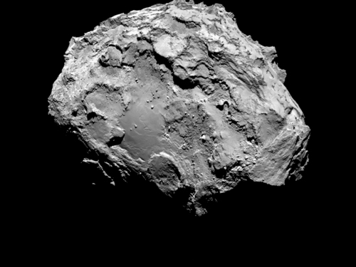 In this picture taken on Aug. 3, 2014 by Rosetta's OSIRIS narrow-angle camera Comet 67P/Churyumov-Gerasimenko is pictured from a distance of 285 kms. A mission to land the first space probe on a comet reaches a major milestone when the unmanned Rosetta spacecraft finally catches up with its quarry on Wednesday, Aug 6, 2014. It's a hotly anticipated rendezvous: Rosetta flew into space more than a decade ago and had to perform a series of complex maneuvers to gain enough speed to chase down the comet on its orbit around the sun. The image resolution is 5.3 metres/pixel. (AP Photo/ESA/Rosetta/MPS for OSIRIS Team )