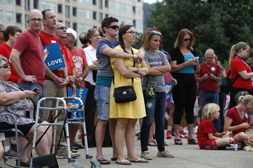 Hundreds gather along with the group Why Marriage Matters Ohio at a rally for gay marriage in Lytle Park, Tuesday, Aug. 5, 2014 in Cincinnati. Federal appeals courts soon will hear arguments in gay marriage fights from nine states, part of a slew of cases putting pressure on the U.S. Supreme Court to issue a final verdict. (AP Photo/The Cincinnati Enquirer, Jeff Swinger)