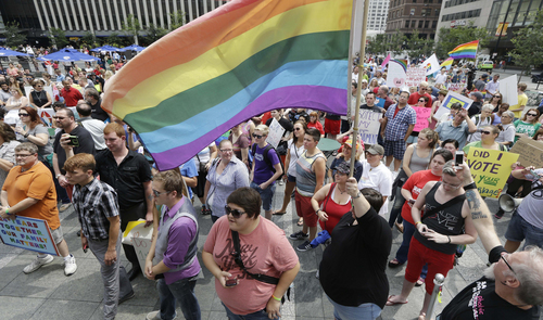 Hundreds of gay marriage supporters rally on Fountain Square, Wednesday, Aug. 6, 2014, in Cincinnati. Three judges of the 6th U.S. Circuit Court of Appeals in Cincinnati are set to hear arguments Wednesday in six gay marriage fights from four states, Kentucky, Michigan, Ohio and Tennessee. (AP Photo/Al Behrman)