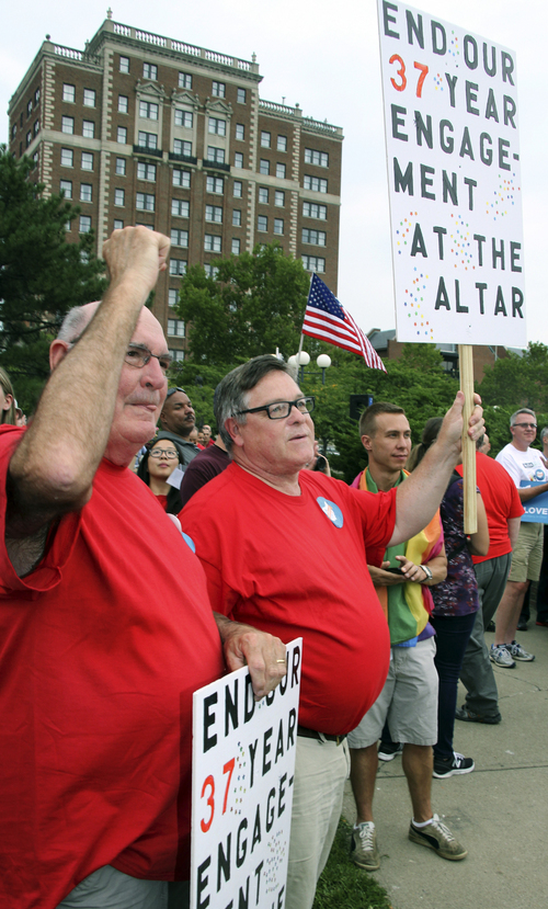 Gay marriage supportersDavid Donovan, left, and Barry Schlaile join others in support of gay marriage during a rally in downtown Cincinnati on Tuesday, Aug. 5, 2014. (AP Photo/Tom Uhlman)