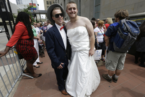 Matt Morris, left, and Jon Bradford pose outside the Potter Stewart United States Courthouse, Wednesday, Aug. 6, 2014, in Cincinnati. The couple hope to marry. Three judges of the 6th U.S. Circuit Court of Appeals in Cincinnati are set to hear arguments Wednesday in six gay marriage fights from four states, Kentucky, Michigan, Ohio and Tennessee. (AP Photo/Al Behrman)