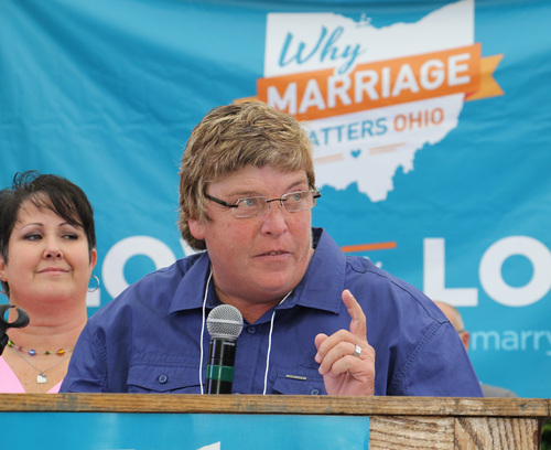 Gay marriage supporter Kim Franklin, speaks to supporters of gay marriage during a rally in downtown Cincinnati on Tuesday, Aug. 5, 2014. Franklin is one of the plaintiffs for a case being argued before the 6th U.S. Circuit Court of Appeals in Cincinnati on Wednesday. (AP Photo/Tom Uhlman)