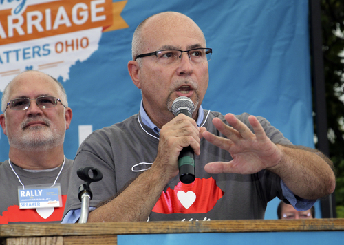 Gay marriage supporter Timothy Love speaks to other supporters with his husband Lawrence Ysunza-Love, left, during a rally in support of gay marriage in downtown Cincinnati, Tuesday, Aug. 5, 2014. Love is one of the plaintiffs for a case being argued before The 6th U.S. Circuit Court of Appeals in Cincinnati on Wednesday. (AP Photo/Tom Uhlman)