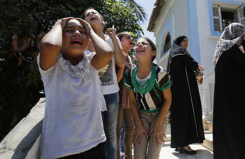 Palestinian relatives of Islamic Jihad militant Shaaban Al-Dahdouh, who was found under the rubble yesterday, cry during his funeral in Gaza City, Wednesday, Aug. 6, 2014. (AP Photo/Hatem Moussa)