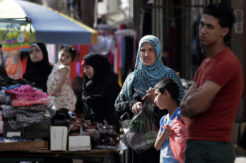 Palestinians shop at a market in Gaza City, northern Gaza Strip, Wednesday, Aug. 6, 2014.  A cease-fire between Israel and Hamas that ended a month of fighting is holding for a second day, ahead of negotiations in Cairo on a long-term truce and a broader deal for the war-ravaged Gaza Strip. (AP Photo/Lefteris Pitarakis)