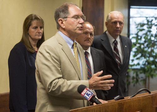 Rick Egan  |  The Salt Lake Tribune  Mayor Bob Stevenson, Layton, announces announce a November citizens ballot on what to do with the high-speed UTOPIA network, at West Valley City Hall Wednesday, August 6, 2014. Mayors in the background are Karen Cronin (left) Perry, Tyler Vincent, Brigham City, and Ron Bigelow, West Valley City, far right.