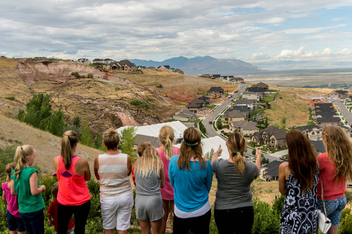 Trent Nelson  |  The Salt Lake Tribune Onlookers take in the scene of a large landslide in North Salt Lake that destroyed one home and caused the evacuation of dozens more, Tuesday August 5, 2014.