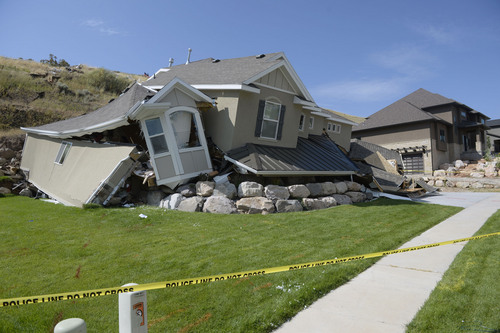 Al Hartmann  |  The Salt Lake Tribune  A  home destroyed by a landslide at Parkway Drive in North Salt Lake. Residents returned to their  homes Wednesday, a day after a landslide destroyed the home and others had to be evacuated.
